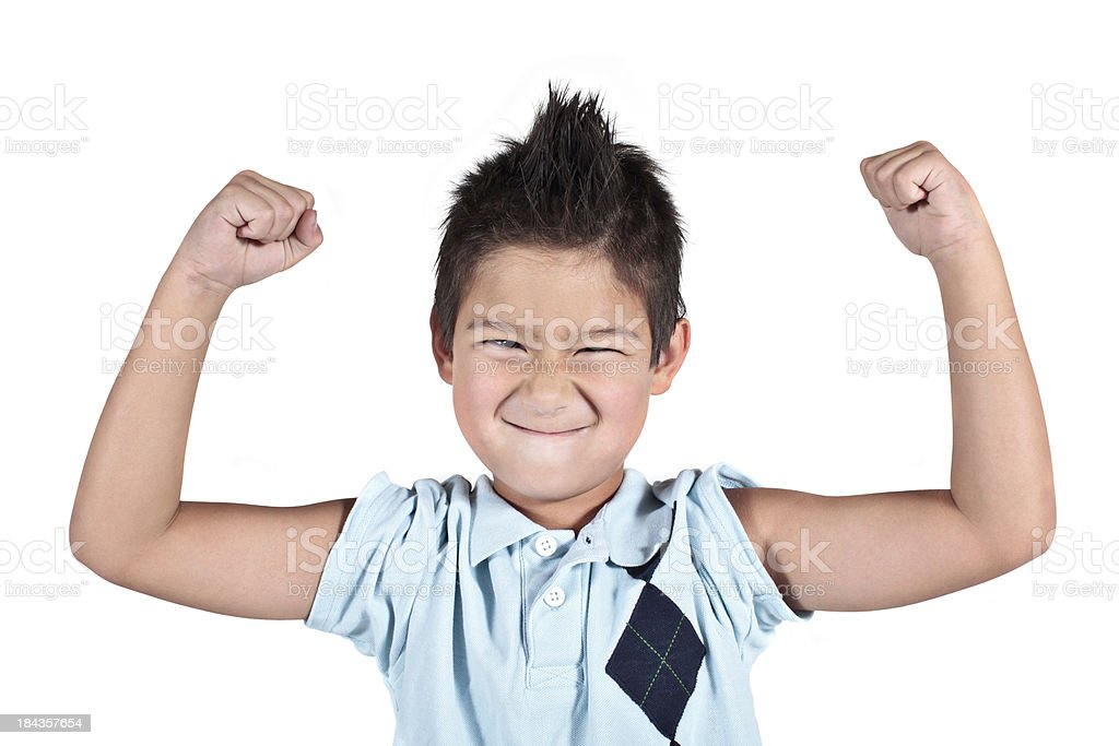 Little young boy flexing his arms and making a face royalty-free stock photo