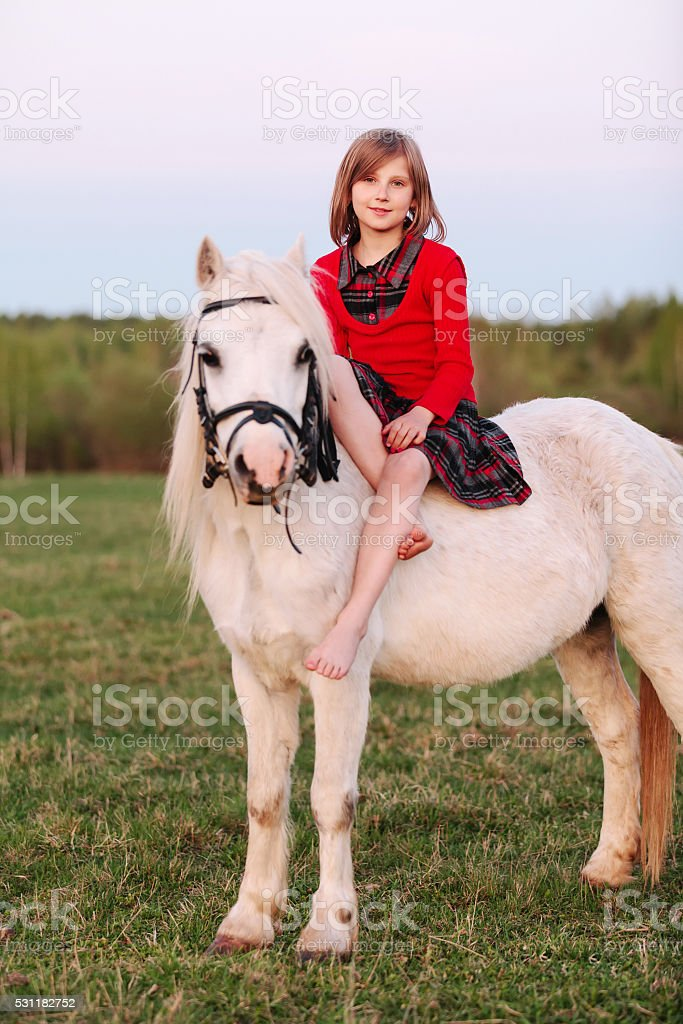 Little Young Girl Sitting Astride A White Horse And Smiling Stock Photo Download Image Now Istock