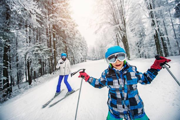 Littlo boy skiing with mother picture id869611012?b=1&k=6&m=869611012&s=612x612&w=0&h= adwe8emrrhuz9wrsavffjiruonighsrndb qbyf7t4=