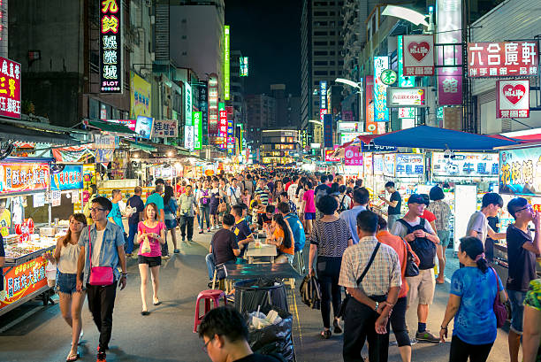 Liuhe Night Market Kaohsiung, Taiwan - September 3, 2016: night view of Liuhe Night Market, one of the biggest and most famous night markets in Kaohsiung night market stock pictures, royalty-free photos & images