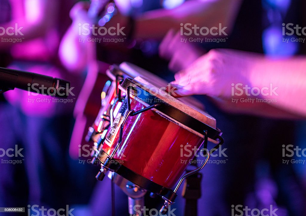 Live band playing bongo drums detail close up stock photo