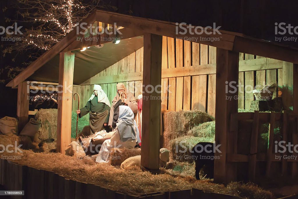 Live Christmas nativity scene reenacted in a medieval barn royalty-free stock photo