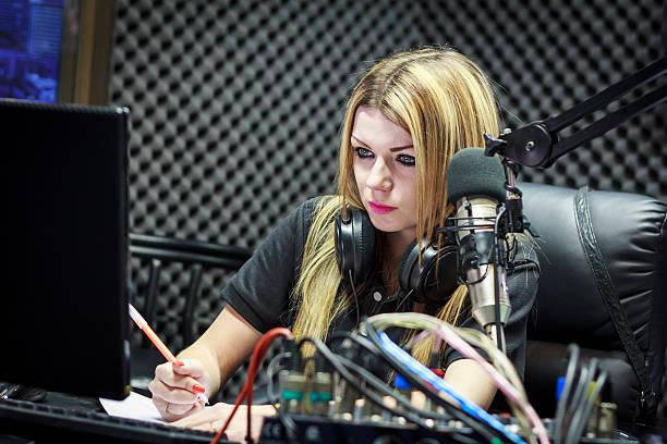 live in studio - radio dj stock photos and pictures