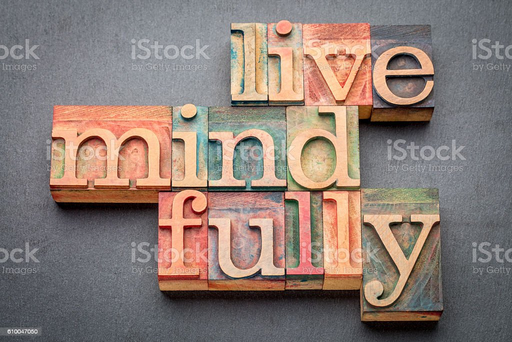 live mindfully in wood type stock photo