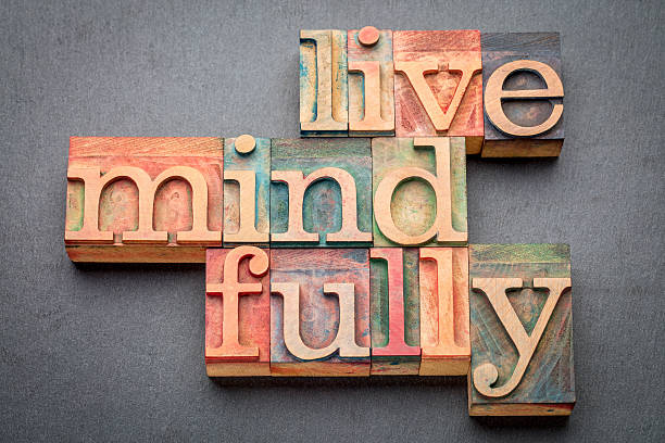 live mindfully in wood type - mindfulness stock photos and pictures