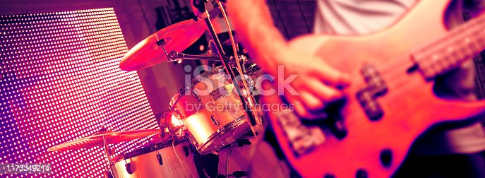 Bassist and drum in the stage.Night entertainment and leisure.Pop and rock band in concert