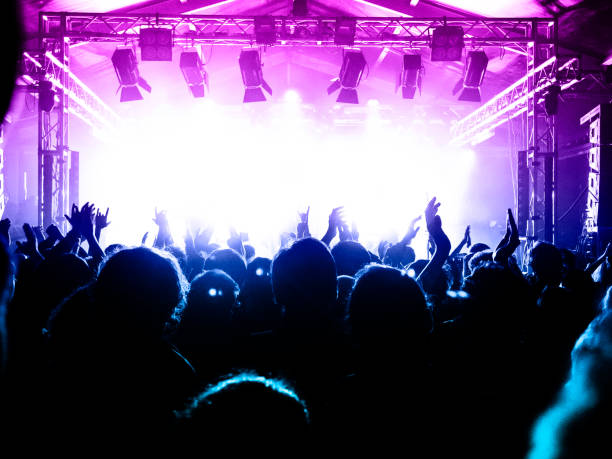 Live music crowd Concert spectators in front of a bright stage with live music spectator stock pictures, royalty-free photos & images