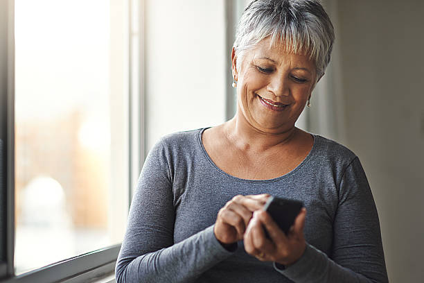 live smarter, live better - older woman phone stock photos and pictures