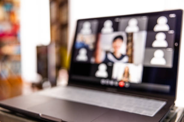 Live streaming video conference. Woman hosting a call waiting for Users attendance stock photo