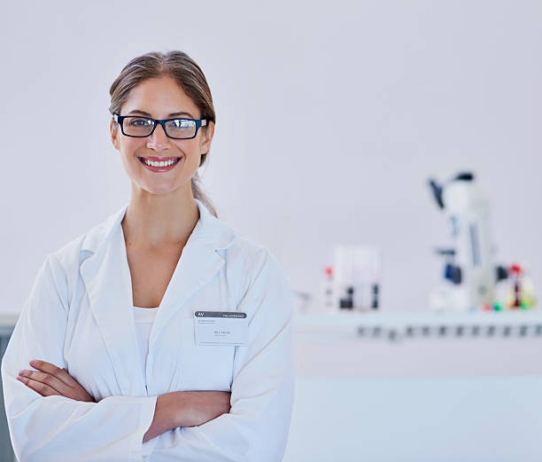 I live to find new discoveries Portrait of a smiling scientist standing in a laboratory microbiologist stock pictures, royalty-free photos & images