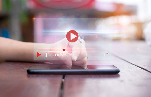 live video content online streaming marketing concept. .Close-up of female hands using mobile phone video stock pictures, royalty-free photos & images