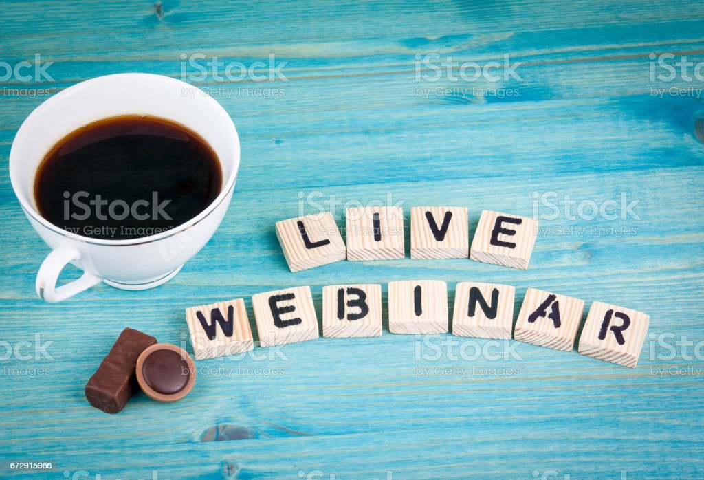 live webinar. Coffee mug and wooden letters on wooden background stock photo