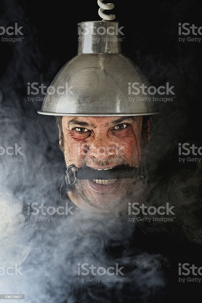 Man being electrocuted. close up. Low key with smoke.