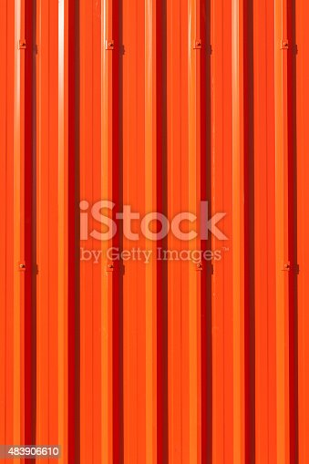 607593268istockphoto Lively red corrugated painted metal wall background. 483906610