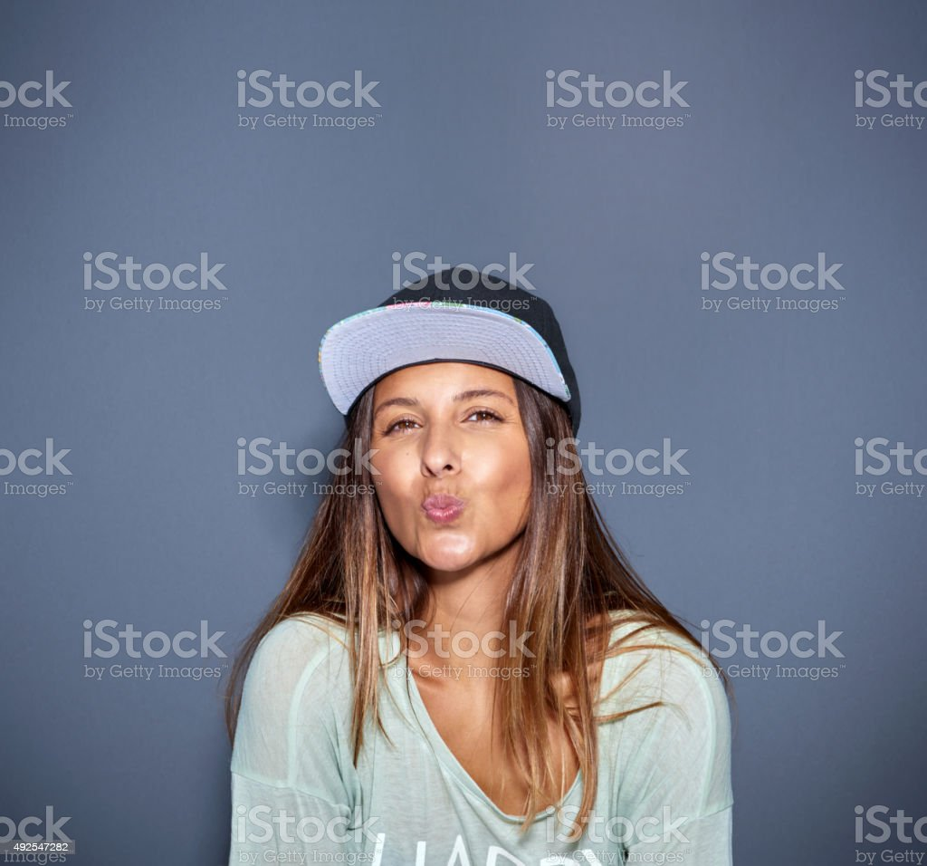 Lively woman kissing at the camera stock photo