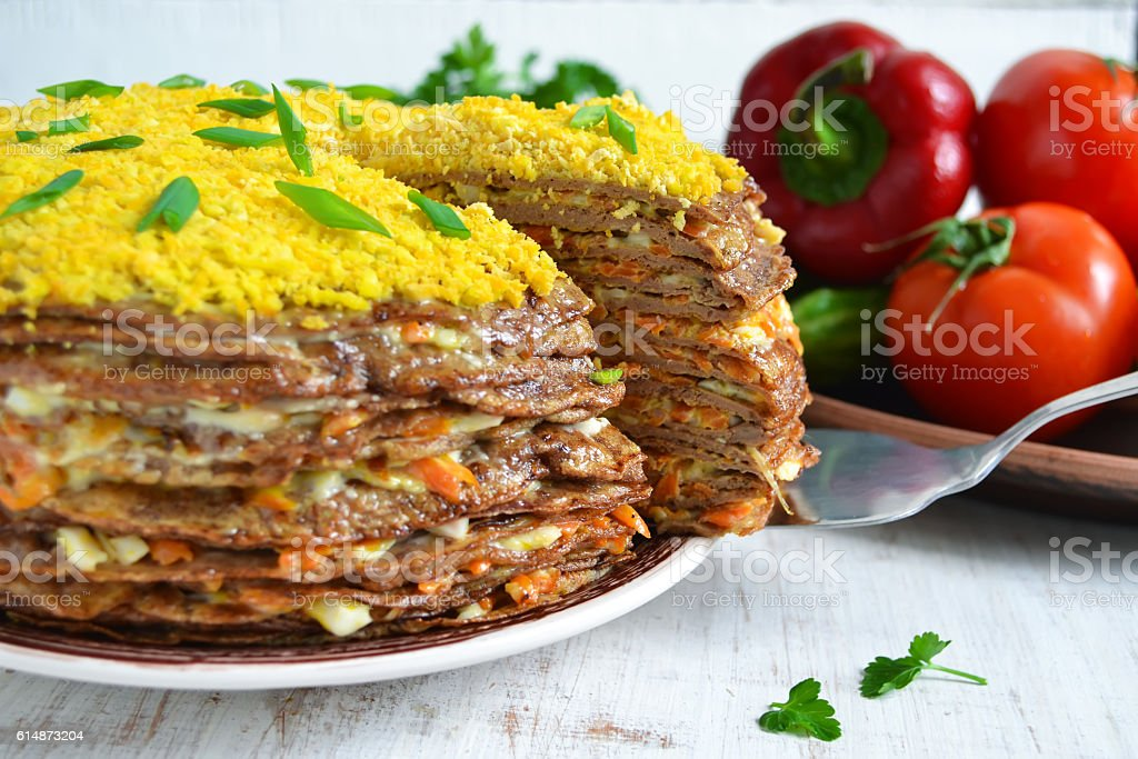Liver cake, cake of liver pancakes stuffed with carrots stock photo