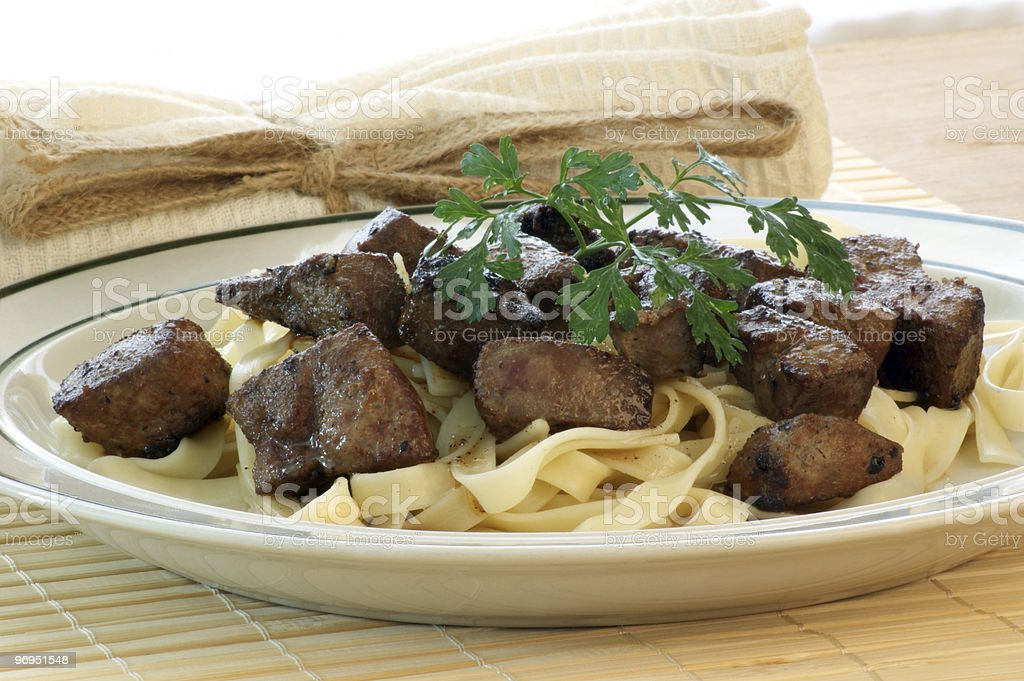 liver goulash on pasta with organic parsley royalty-free stock photo
