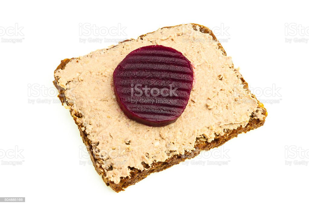liver paste and beetroot on rye bread stock photo