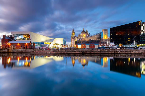 Liverpool Docks Waterfront Wide angle view of iconic landmarks on the Liverpool waterfont, taken at dusk. Liverpool, England. northwest england stock pictures, royalty-free photos & images
