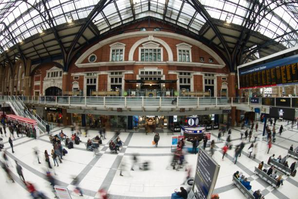Liverpool Street Station, London Fisheye slow shutter View of the main concourse at Liverpool Street Station, London. skeable stock pictures, royalty-free photos & images