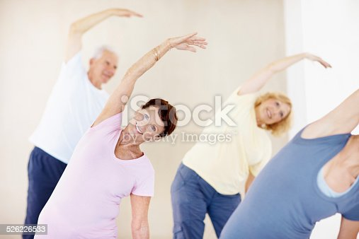Shot of smiling seniors enjoying a yoga class together