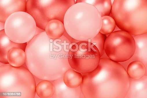 istock Living coral color background of metallic Christmas balls 1078384768