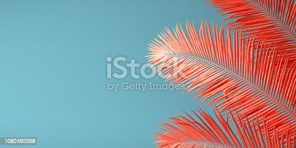 istock Living Coral color of the Year 2019. Background with palm in trendy color 1082492058