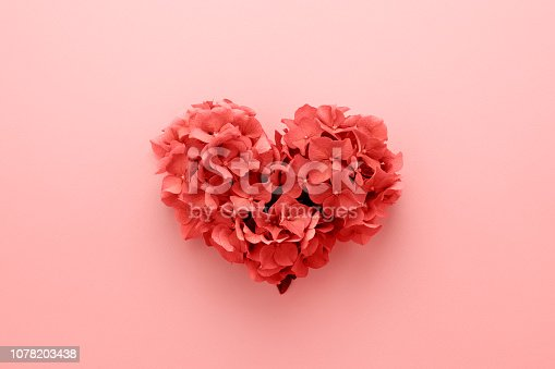 istock Living Coral color of the Year 2019 Heart shape made of flowers. 1078203438