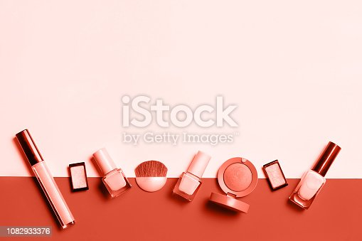 istock Living Coral decorative cosmetic on pink background. 1082933376