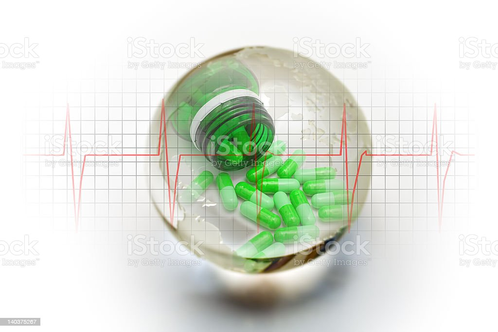 Living Earth with heartbeat and green pills stock photo