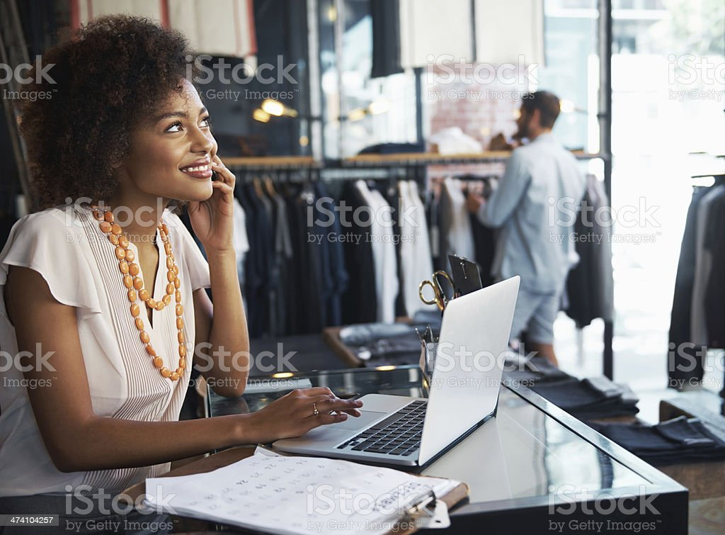 Living her dream - owning a boutique royalty-free stock photo