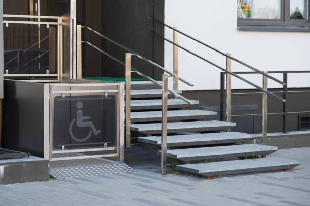 Living house entrance equipped with special lifting platform for wheelchair users Living house entrance equipped with special lifting platform for wheelchair users accessibility stock pictures, royalty-free photos & images