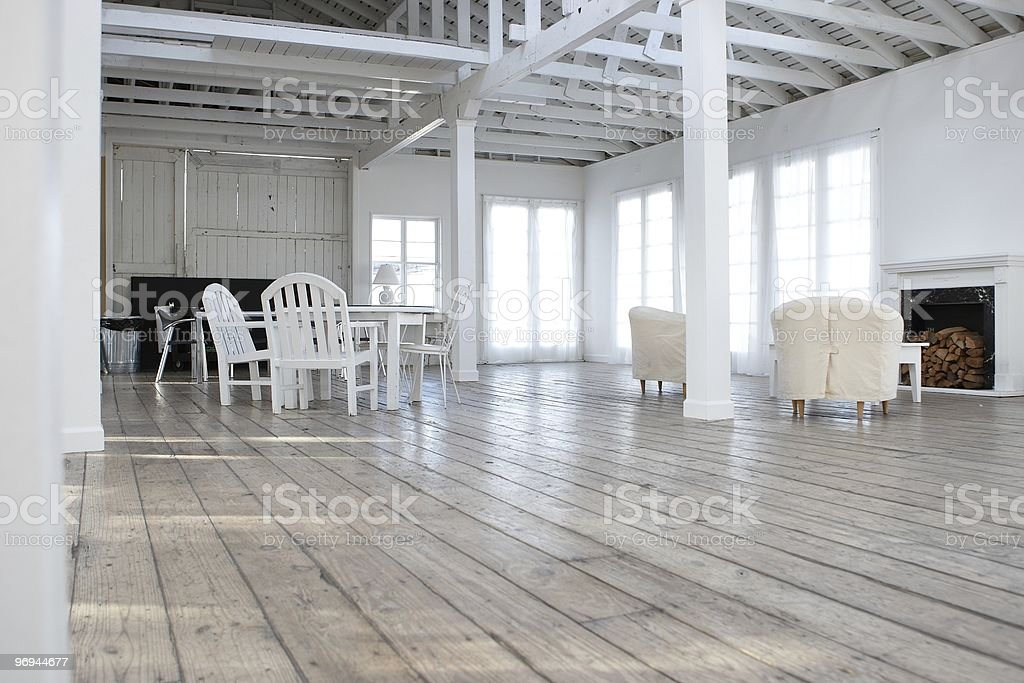 living room and dining table with chimney royalty-free stock photo