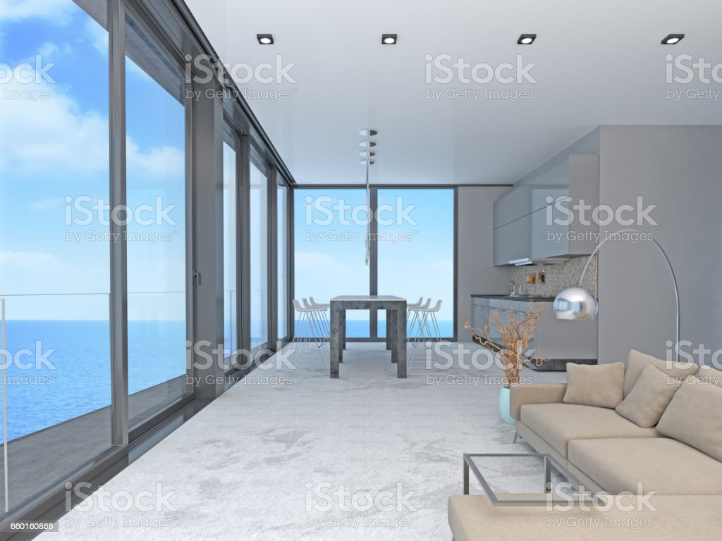 Living room and kitchen with windows and view of sea stock photo