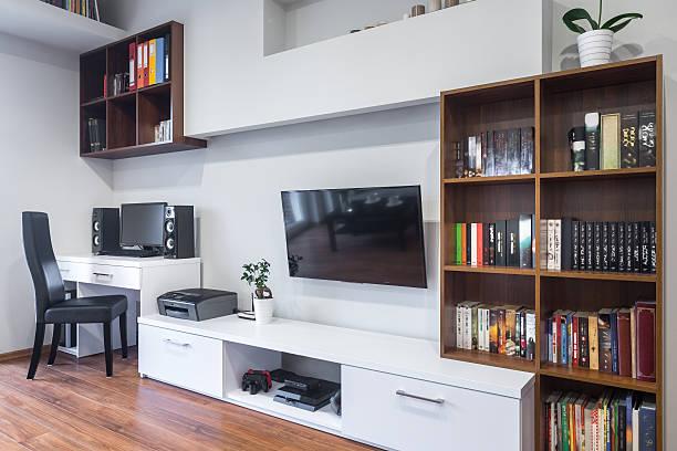 living room and office combined - arbeitszimmer möbel stock-fotos und bilder