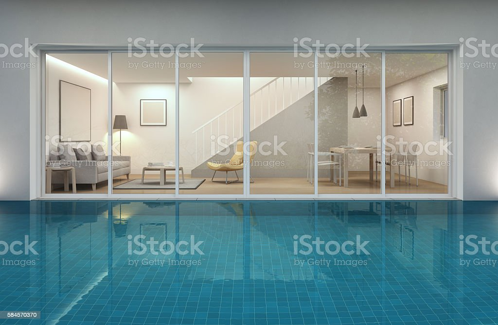 living room, dining room and swimming pool in modern house stock photo