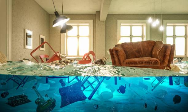 living room flooded with floating chair and no one above. - danificado imagens e fotografias de stock