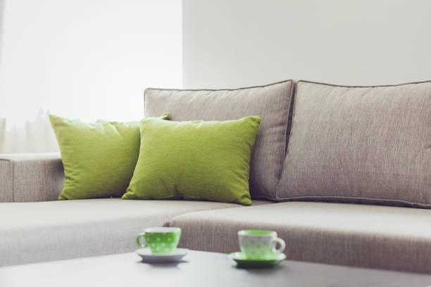 living room furniture decor - tischsofa stock-fotos und bilder