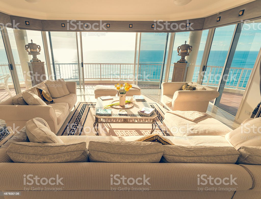 Living room in a luxury beachfront apartment with view stock photo