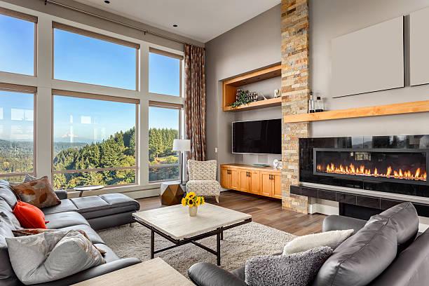 wohnzimmer der luxus, sich wie zu hause mit herrlichem blick auf die berge - große wohnzimmer stock-fotos und bilder