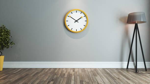living room interior design idea with big yellow watch stock photo