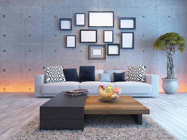 wohnzimmer interior design mit beton wand und bilderrahmen - zeitschrift wandkunst stock-fotos und bilder