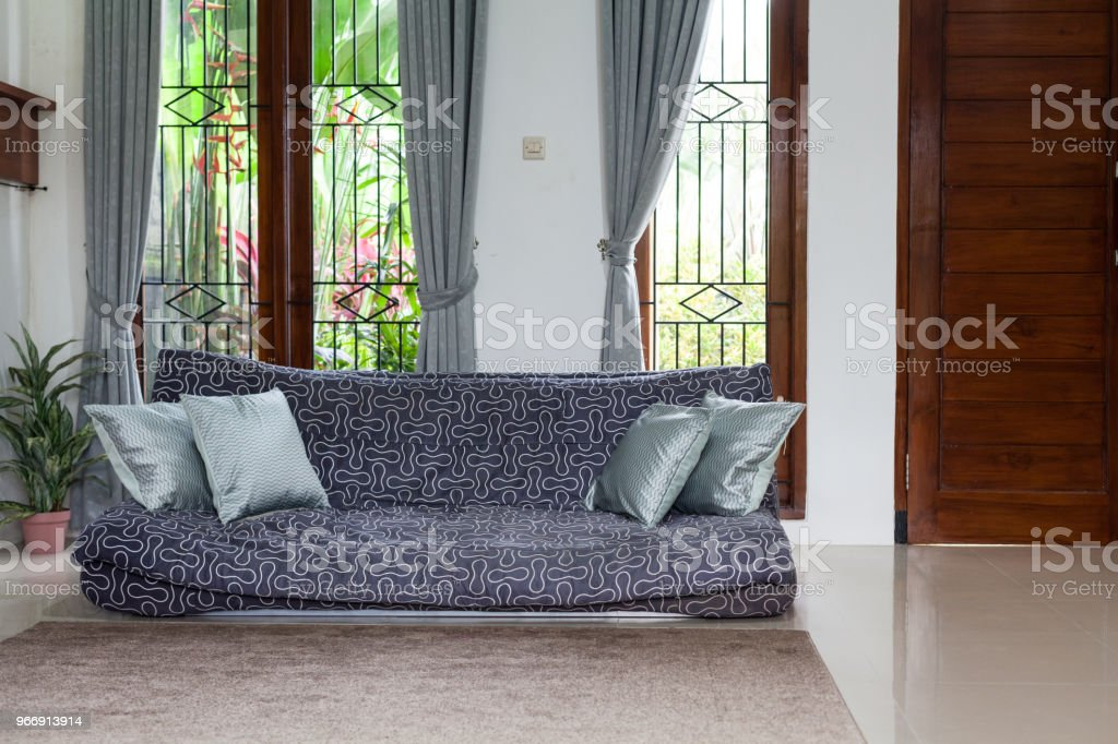Living room interior. Old sofa with pillows in the room on the...