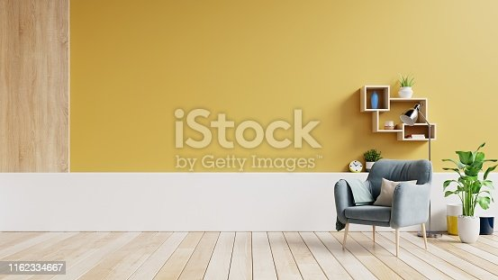 Living room interior with fabric armchair ,lamp,book and plants on empty yellow wall background.3d rendering