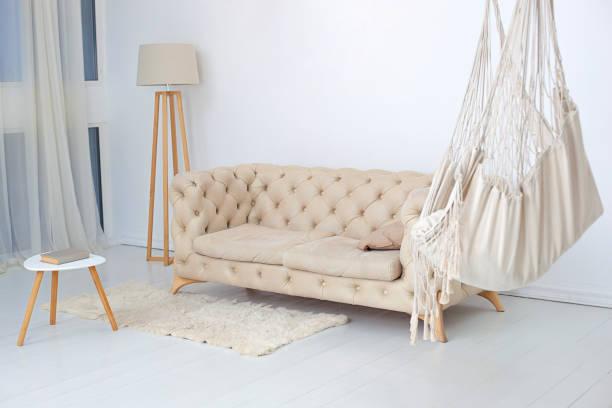 Living room interior with hammock fluffy rug and coffee table with picture id1200154370?b=1&k=6&m=1200154370&s=612x612&w=0&h=o1hadwpbclpx ta4ka34qcbx ybwy8w96qij9yhuhge=