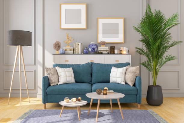 Wohnzimmer-Interieur mit Bilderrahmen an grauen Wänden – Foto