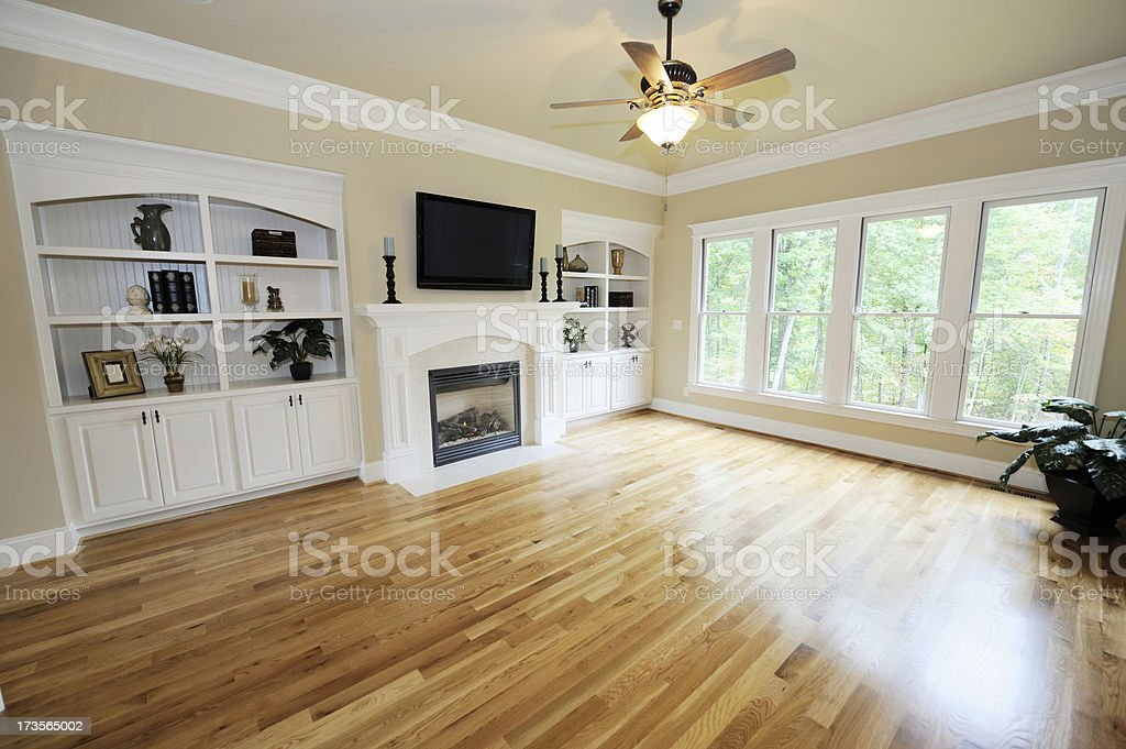 Living room interior with tan wooden floor and no sofas royalty-free stock photo