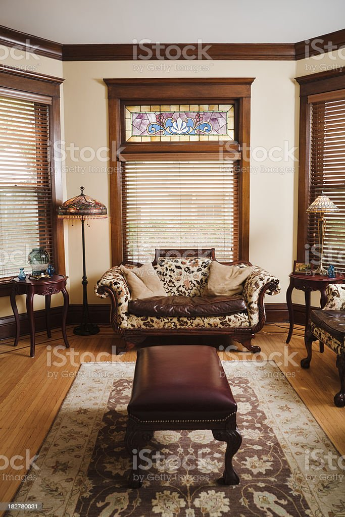 living room of a traditional victorian style home vt stock