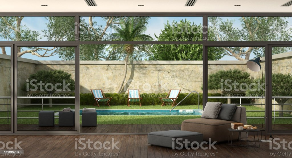 Living room of a villa with pool in the garden stock photo