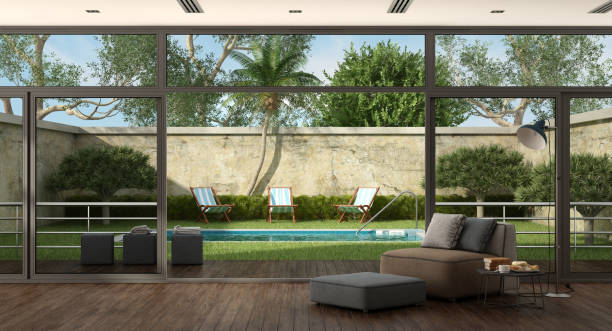Living room of a villa with pool in the garden Living room of a villa overlooking the garden with small pool - 3d rendering  backyard pool stock pictures, royalty-free photos & images